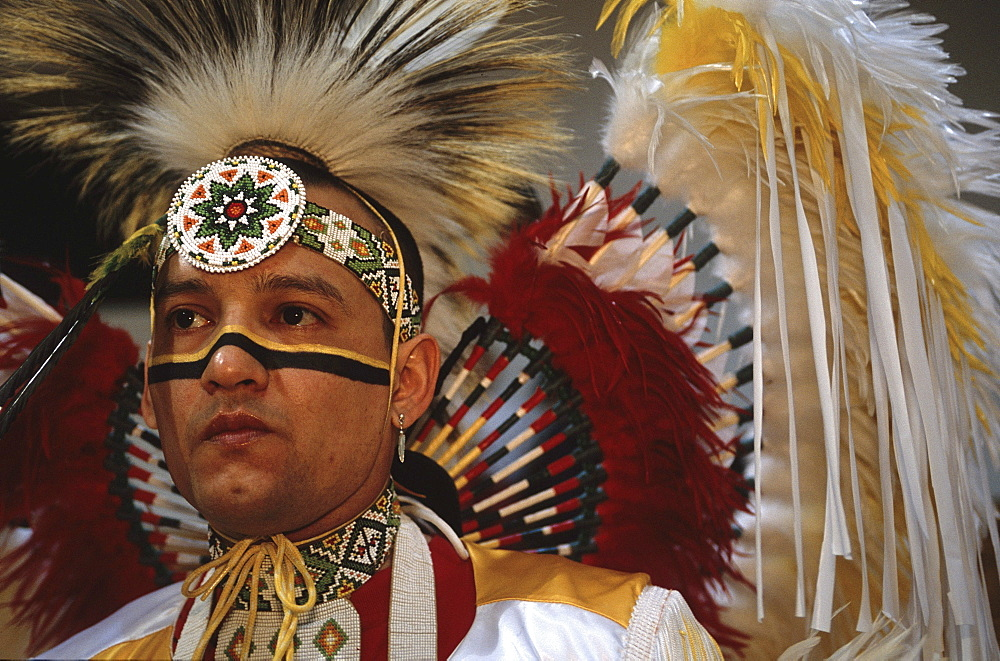 In the hallways of Central High School, St. Paul, Minnesota at a Pow Wow held by the local Indian communities. Dancers and getting ready in the men's locker room and drummers performing in the school gymnasium. - 857-12067