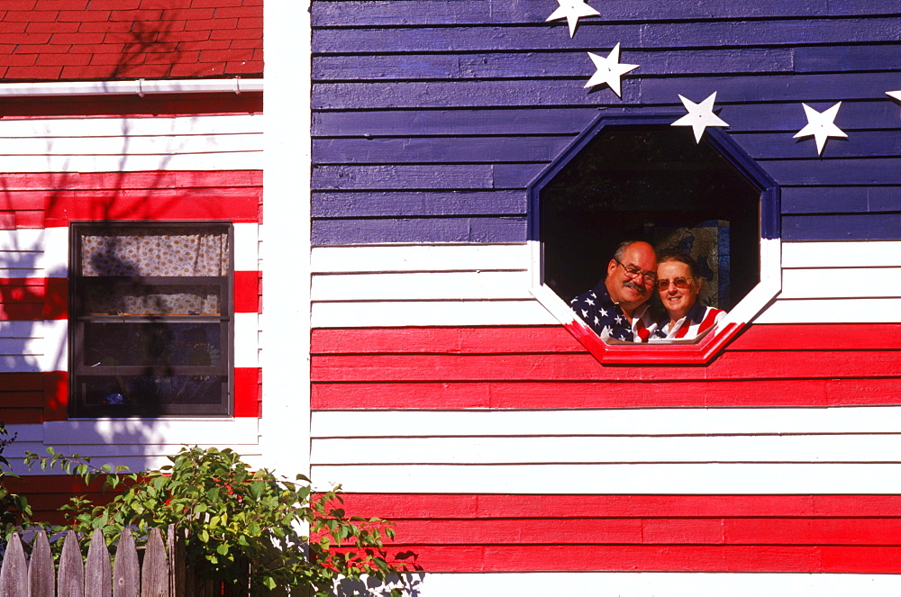Wally and Hellen Rogers of Standish, Maine proudly display their home which is painted on all sides like the American Flag. Long before 9, 11 and the rejuvenation of patriotism and the increased display of Old Glory, the Rogers decided to wear their pride blatantly on the outside walls of their home.