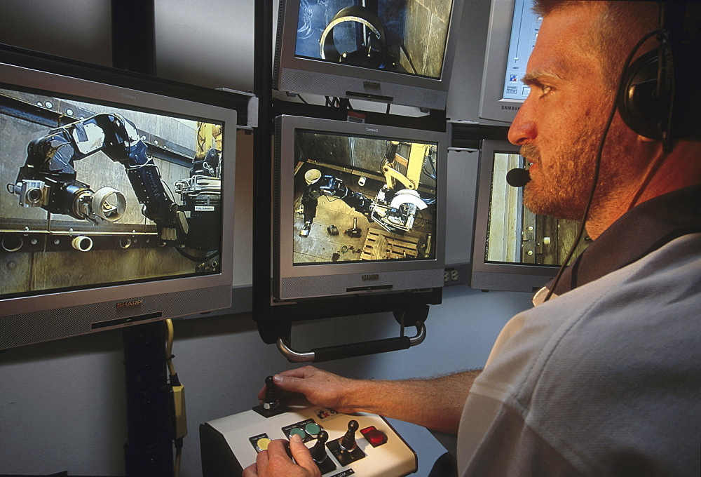 Pit viper Engineer Carl Baker at the controls of the compact remote console of the pit viper at the HAMMER facility, Hanford Nuclear Site, WA. This unit will be used to remotely upgrade pipe fitting in the tank farm. There are 600 pits in the tank farm which are used to transfer waste between tanks.