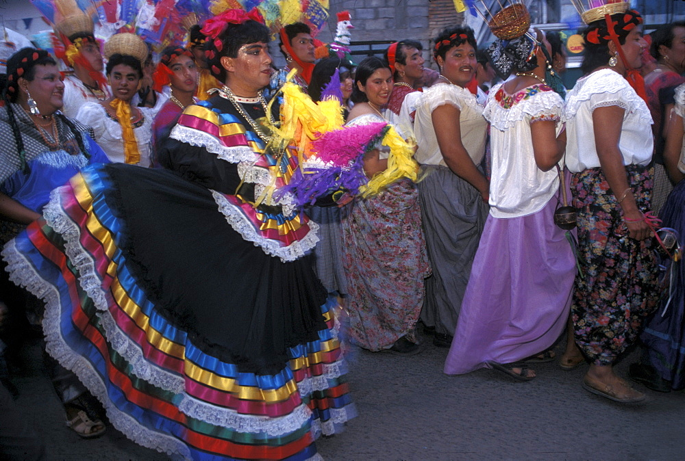 Men in drag parade through the streets o during La Chunta Dance, part of the Fiesta de Enero held each January in Chiapa de Corzo, Chiapas state, Mexico.