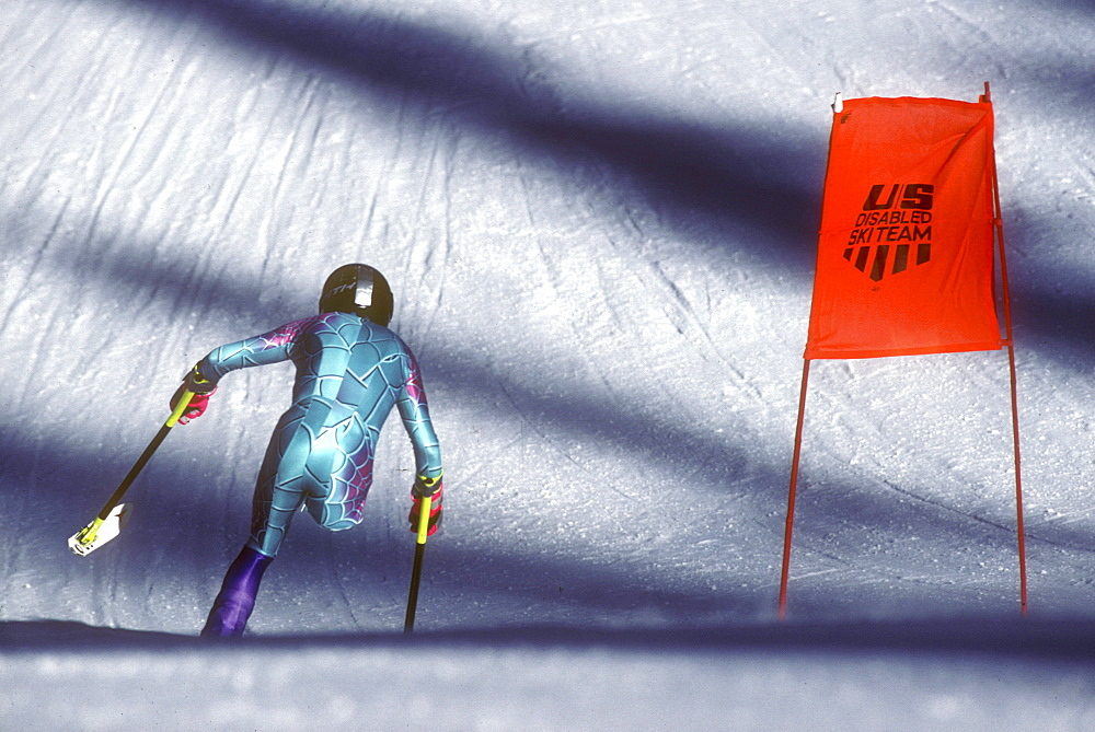 A disabled (amputee) skier, also known as a three-track skier, speeds down a practice race course during a training session for the U.S. Disabled Ski Team at Purgatory Ski Resort near Durango, Colorado