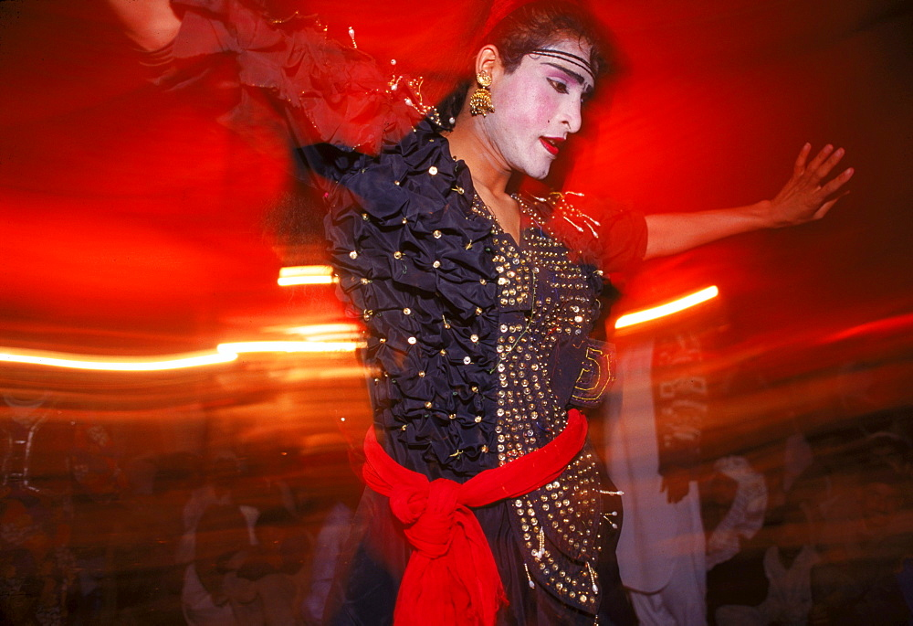 A Hijra dancer entertains the men at a segregated wedding in the Pakistani Punjab