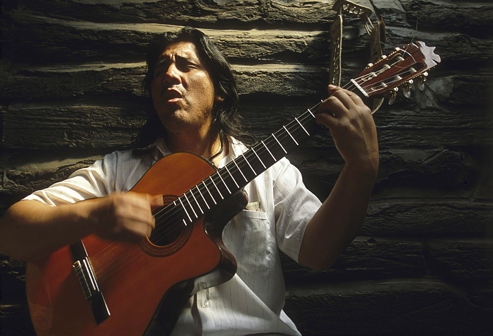 Guitarist Eduardo Paillacan playing Marpuche songs at the train station in Nahuel Pan, Argentina.
