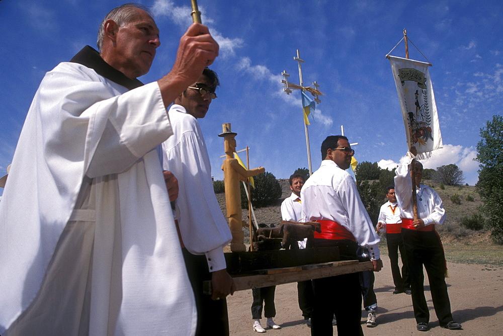 A reenactment of a religious procession at El Rancho de Las Golondrinas, a recreated Hispanic theme village for visitors near Santa Fe, New Mexico