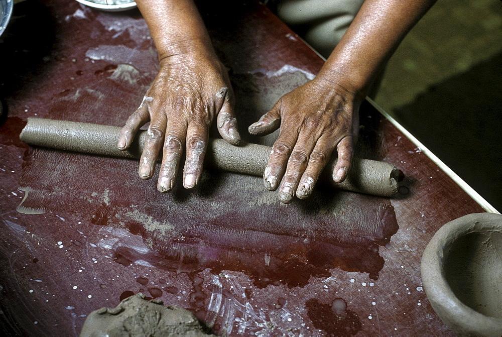 A Pueblo Indian potter makes pottery using traditional hand techniques, Santa Clara Pueblo, New Mexico