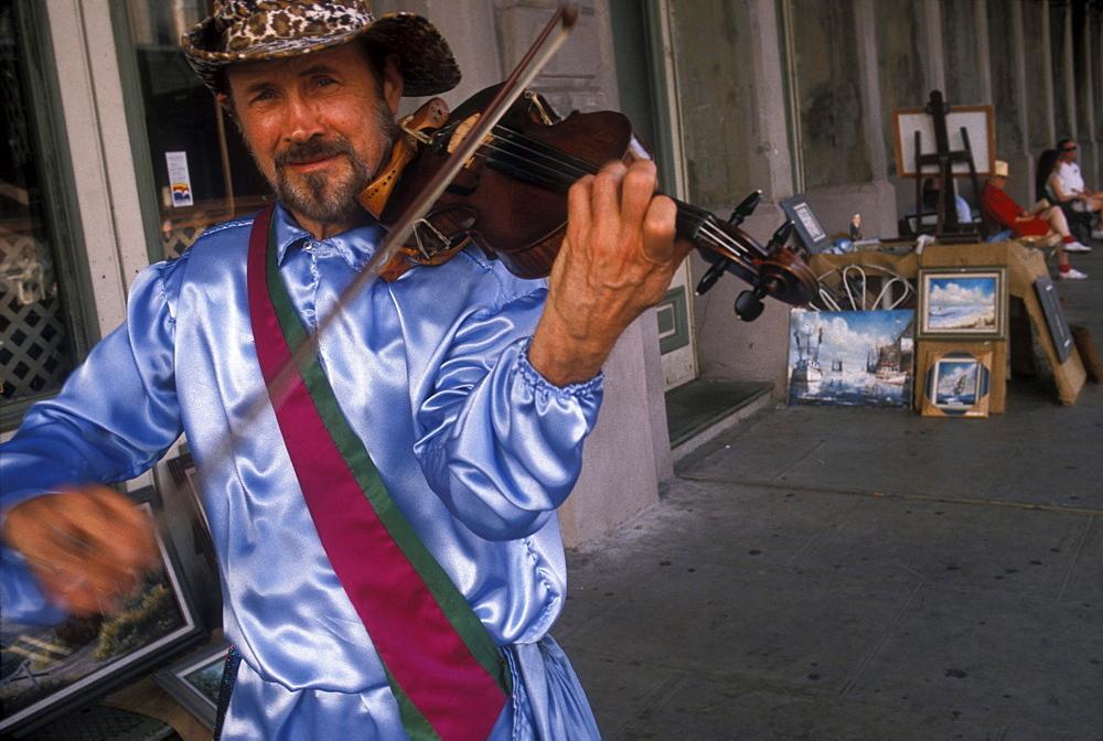 A musician performs during Mardi Gras celebrations in Galveston, Texas