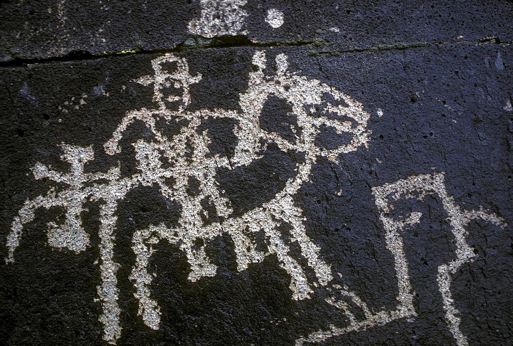 Historic petroglyph carved into a volcanic ridge in the Galesteo Basin near Santa Fe, New Mexico