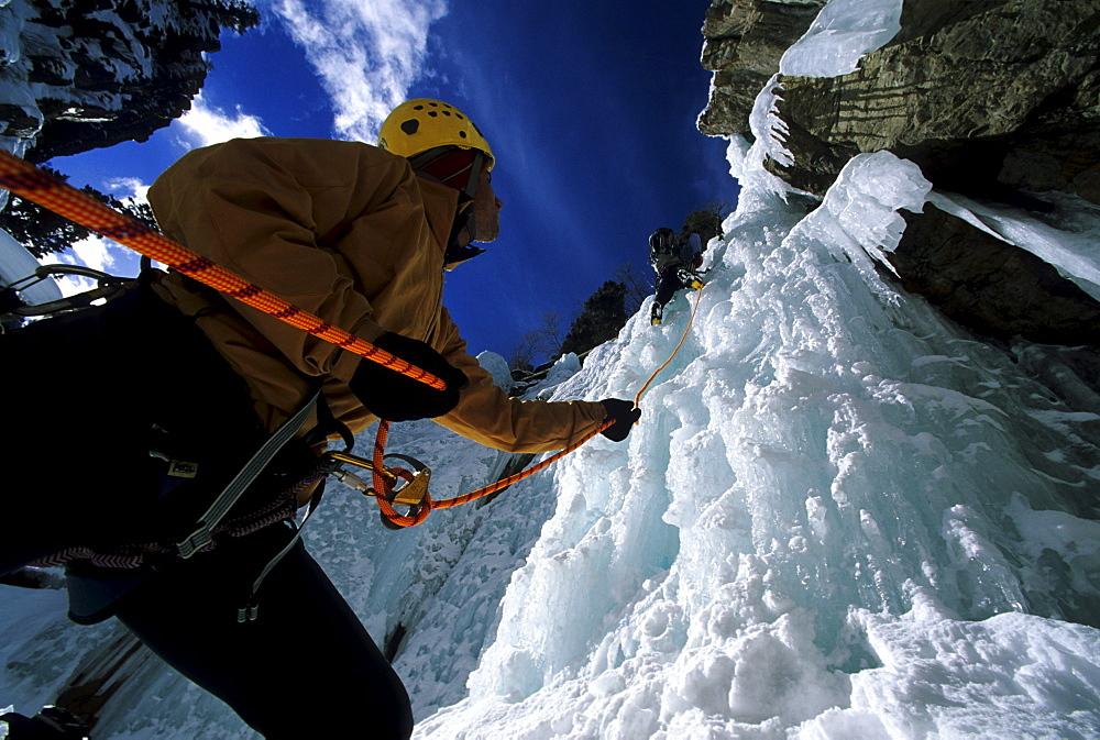 Jamie Blythe climbing the Trestle Wall WI3 Ouray Ice Park, Mike Seamens belays, Colorado