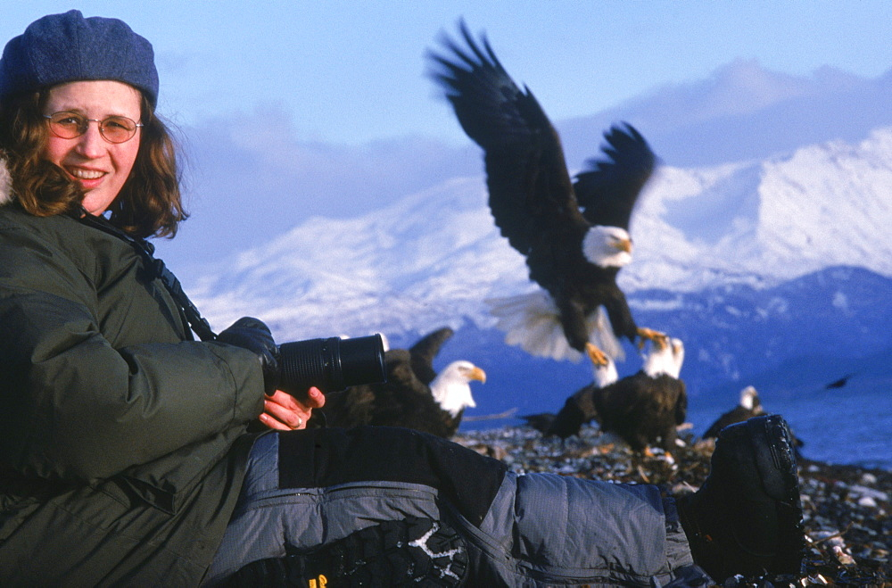 Photographer Ellen Anderson gets close-up while photographing eagles on the Alaska's Homer Spit.