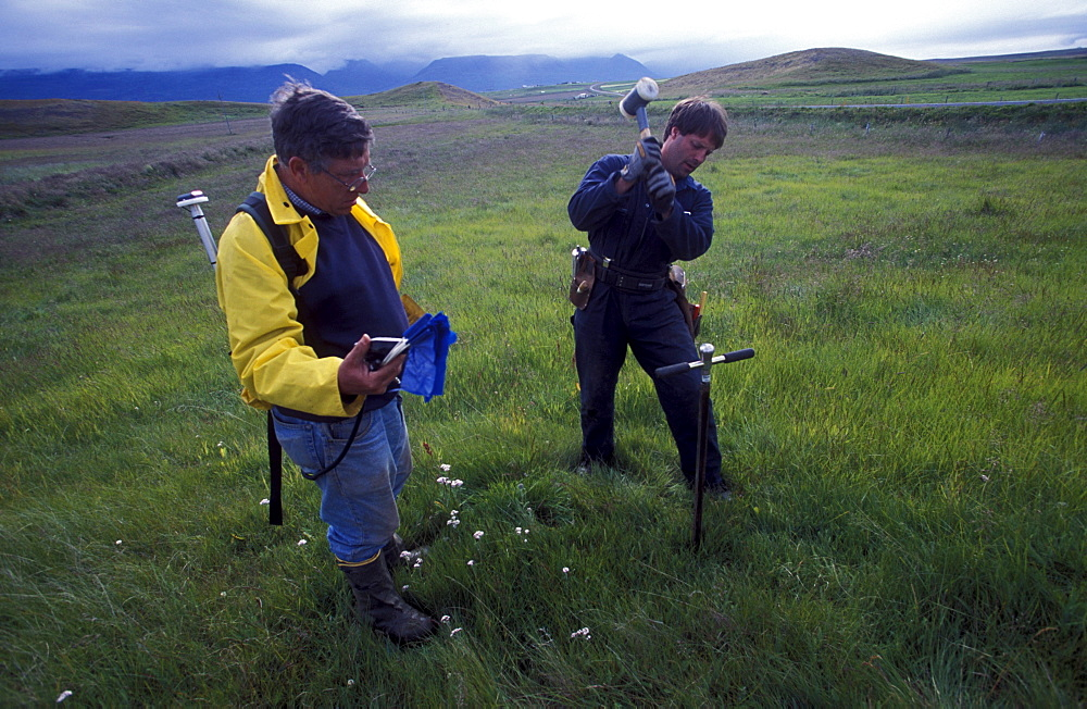 American archeologists, Antonio Gilman and John Steinberg, take a core sample in a farmer's field near Glaumbaer in northcentral Iceland. Steinberg made an important discovery in Glaumbaer in 2001. He found the homestead of Thorfinn Karlsefni, the father of the first European born in the New World. This find has important implications for Viking history.