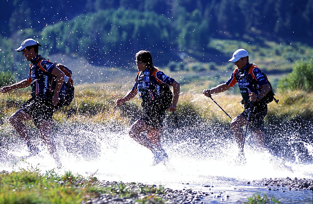 Members of Team Montrail (Novak Thompson, ,Patrick Harper, Rebecca Rusch) train for the next adventure race of the season. The team spends much time hiking, running. In the photo the team crosses a river near Lake Tahoe. Hope Valley, California