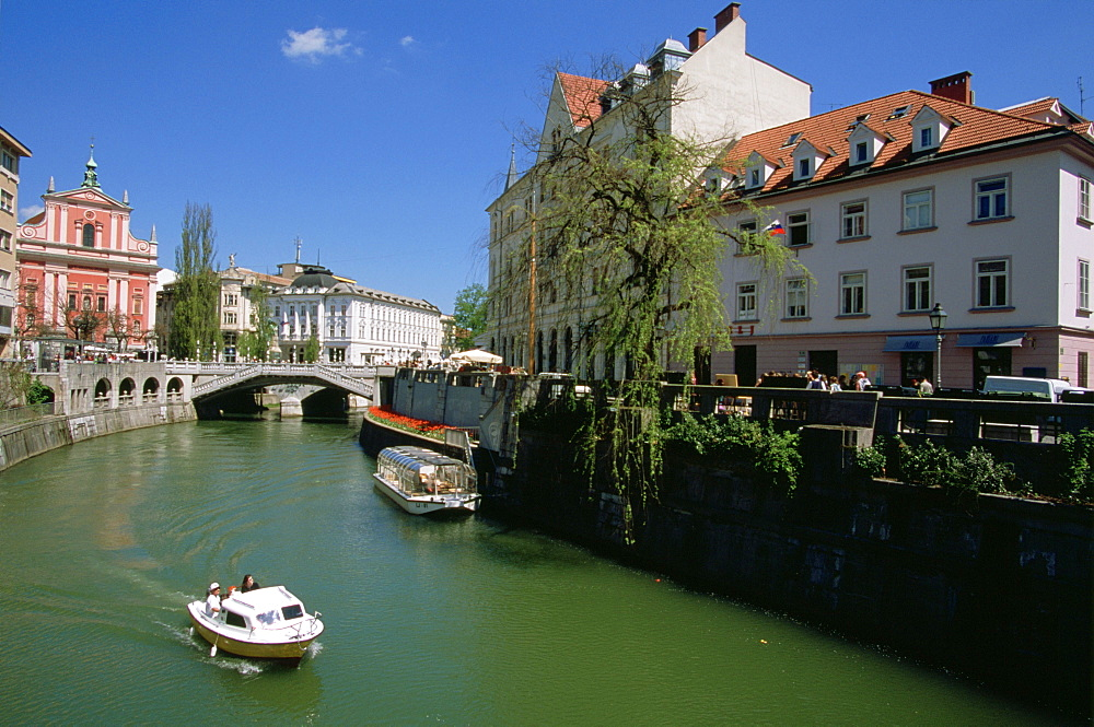 The Ljubljanica River flowing under the Triple Bridge and through Ljubljana, Slovenia's Old Town.