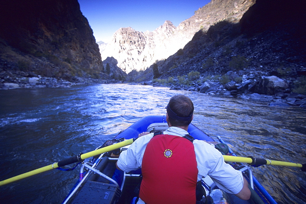 Stan Czarniak rafts through Impassable Canyon on a descent of the Middle Fork Of The Salmon River, Frank Church-River of No Return Wilderness, Idaho.