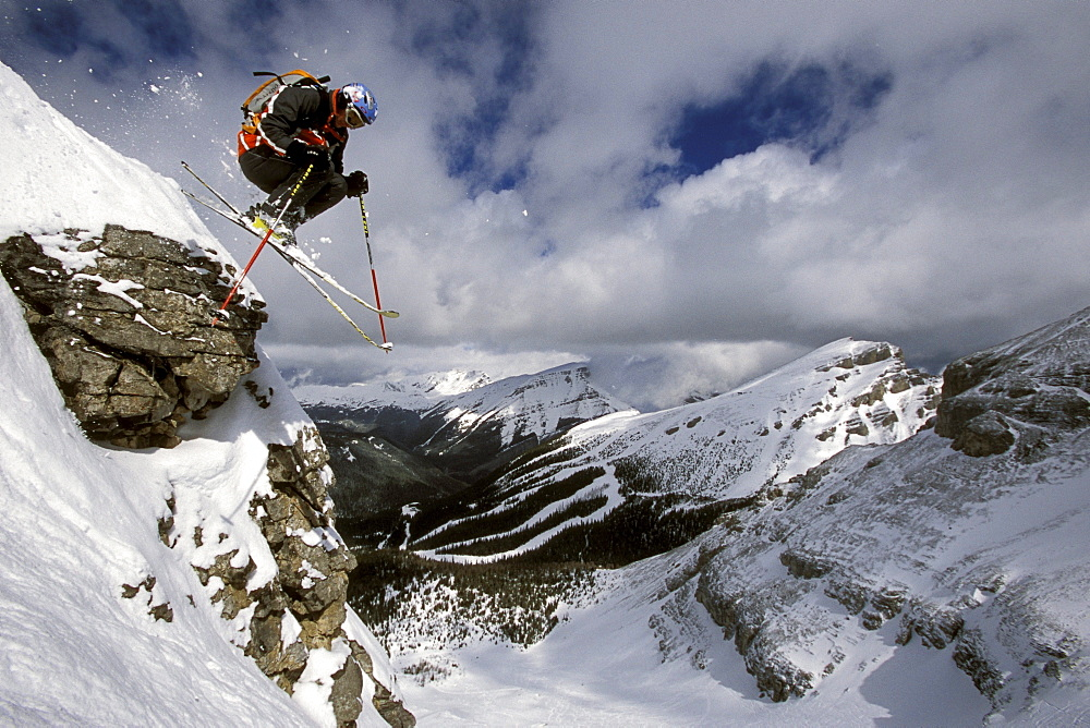 Sven Brunso catches air while skiing Delirium Dive at Sunshine Village Ski Resort in Banff National Park, Alberta, Canada.
