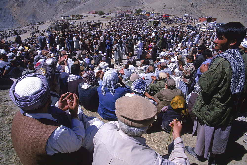 Hundreds of men and boys pray during ceremonies at the shrine of Ahmad Shah Masood in the Panjshir Valley, on the one year anniversary of his assasination, September 9, 2002.. Masood was a revered mujahedin leader who also was one of the leaders of the Northern Alliance which opposed the Taliban and helped the US Military in their defeat.  Masood was assasinated by what are thought to be Al Queda operatives on Sept. 9, 2001.  A shrine has been erected in the Panjshir  Valley  from where he led much of his resistance to both the Soviet and Taliban forces, to honor this latest of Afghan war heros.