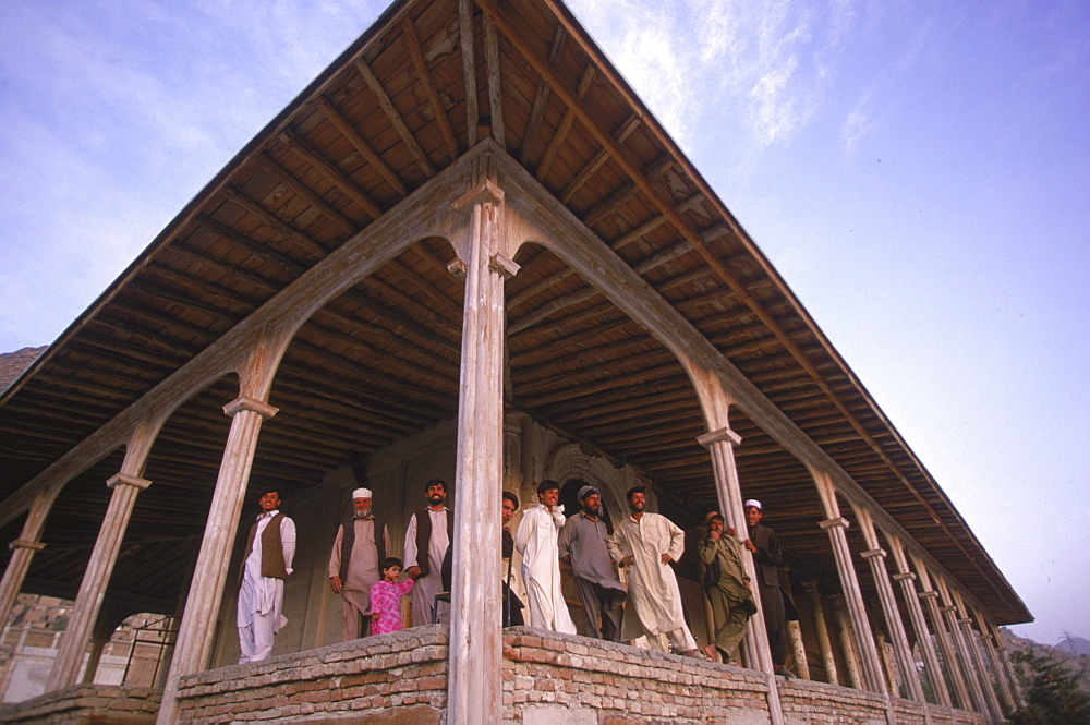Workers pause by the columns of a 19th century summer pavilion in the Babur Gardens, or Bagh-i-Babur, Kabul, Afghanistan, September 25, 2002. The pavilion, which was used as a restaurant in the 20th century, was built by  Amir Abdur Rahman, but was heavily damaged  by the  factional fighting of the mujihadeen in the 1990's  and later by the Taliban.  The  buildings and gardens are now being carefully restored.  Shah Babur, a descendent of Ghengis Khan and grandson of Tamerlane, is credited for founding the  great Moghul dynasty which ruled India for two centuries.  Babur  built the palace and created the gardens on a hill looking over the southern part of Kabul in the 16th century,
