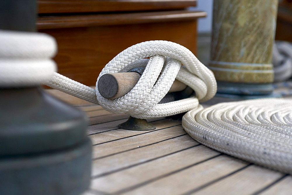 "Winch, cleat and coil, on deck of sailing yacht ""Sincerity."""