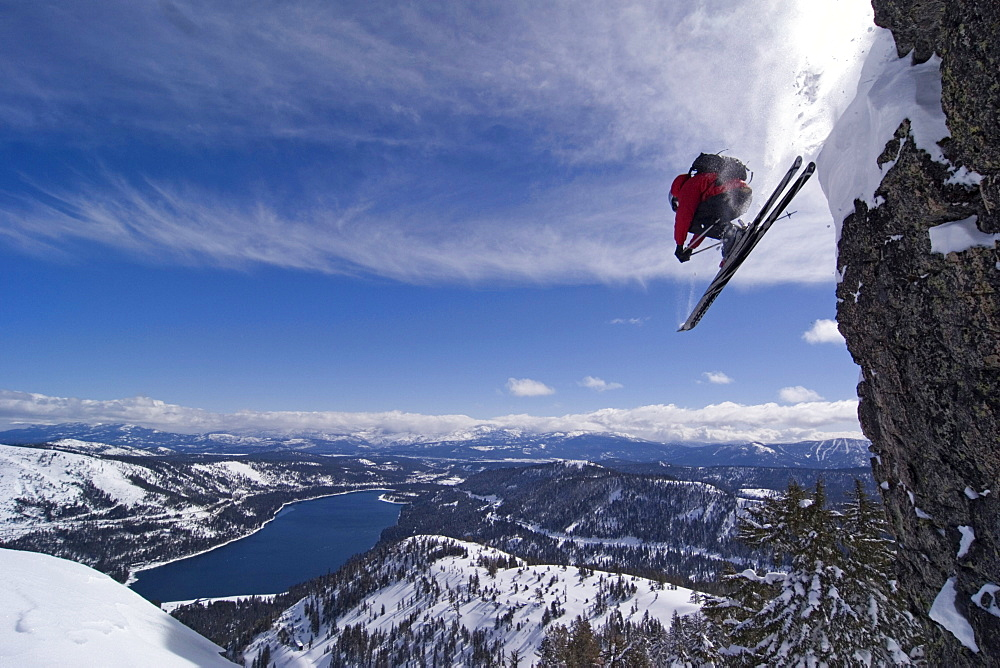 A man skiing off a cliff above Donner Lake California. - 857-36071
