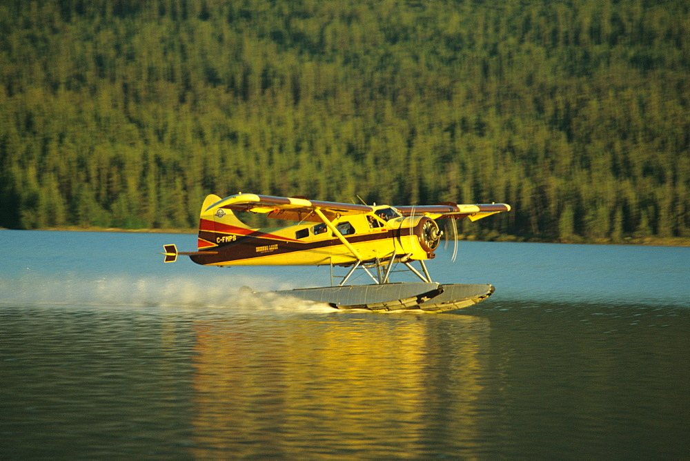 The Inconnu Lodge's DeHavilland Beaver floatplane takes off from McEvoy Lake in Canada's Yukon Territory.