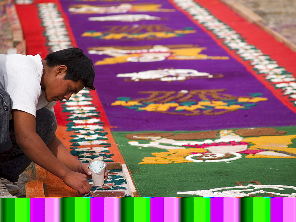 As part of the observance of Lent in Guatemala, a person prepares an aromatic carpet for a procession in Antigua, Guatemala