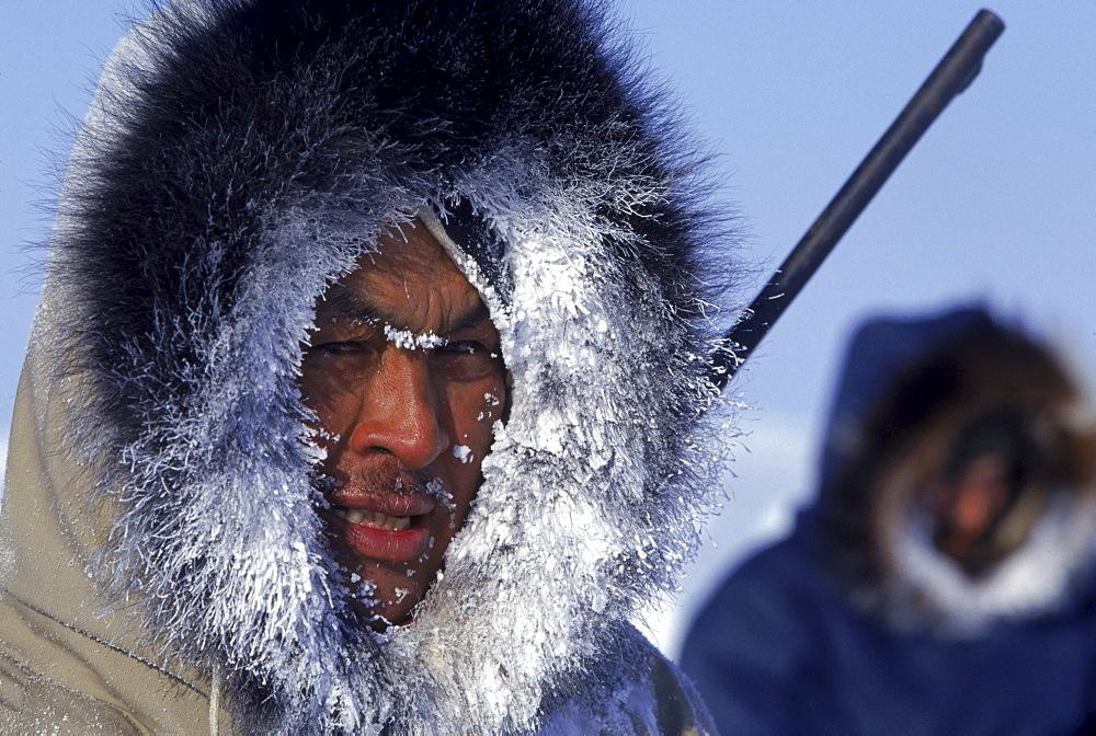 Portrait of Inuit hunter, Daniel Quanatsiag, during polar bear hunt, Nunavut, Canada.