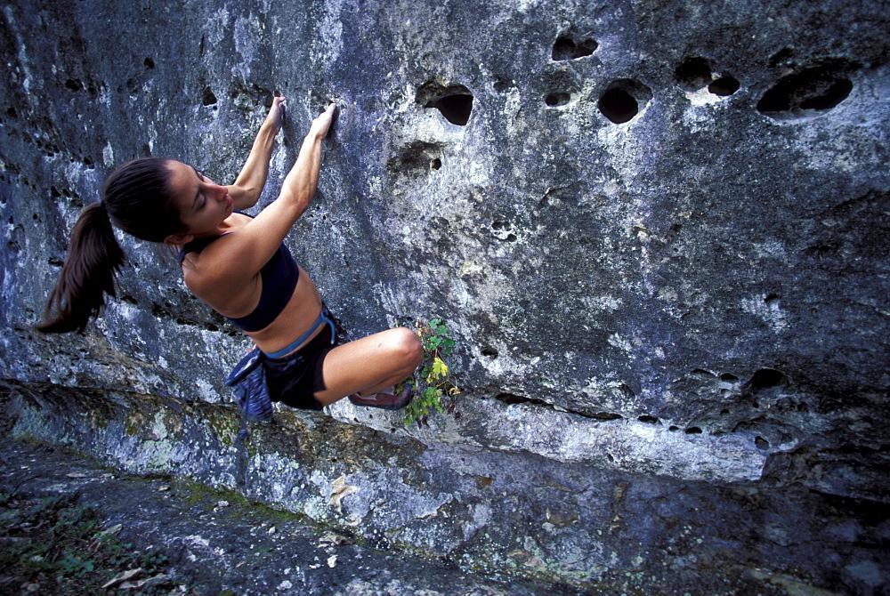 Woman bouldering near Austin, Texas.