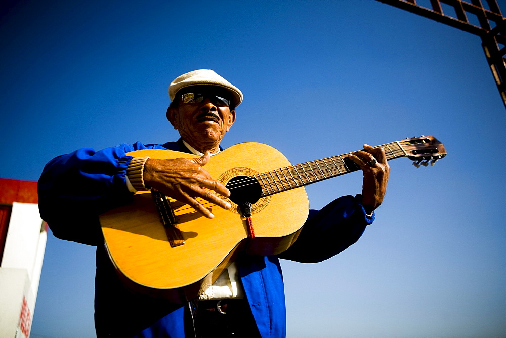 Mariachi guitar player poses for a photo in Tijuana, BC, Mexico.