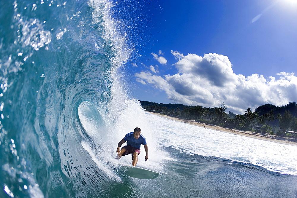 Music Star; Jack Johnson surfing in Hawaii