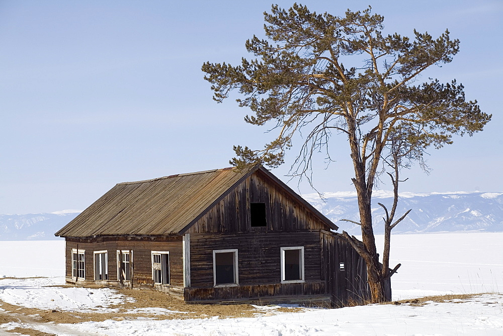 A house during the winter on the shore of Lake Baikal on Olkhon Island, Siberia, Russia.