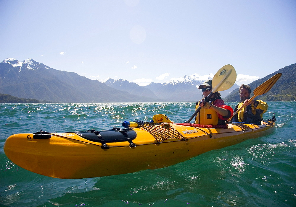 Two people kayak in Lago Yelcho, Chile