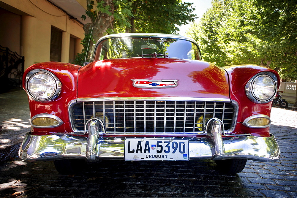 A red classic car parked in the street at Colonia del Sacramento, Uruguay.