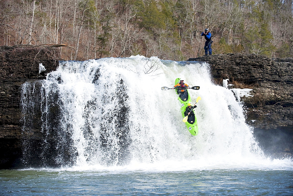 Two professional kayakers in a tandem kayak run falls in Tennessee.