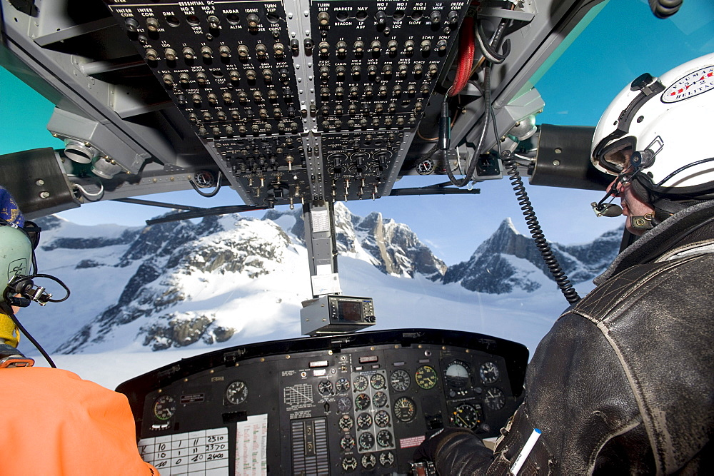 The view through the cockpit while heli-skiing.