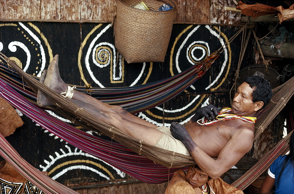 Mukuna man relaxes on hammock.  Eastern Colombia Amazon, Vaupes region. - 857-51223