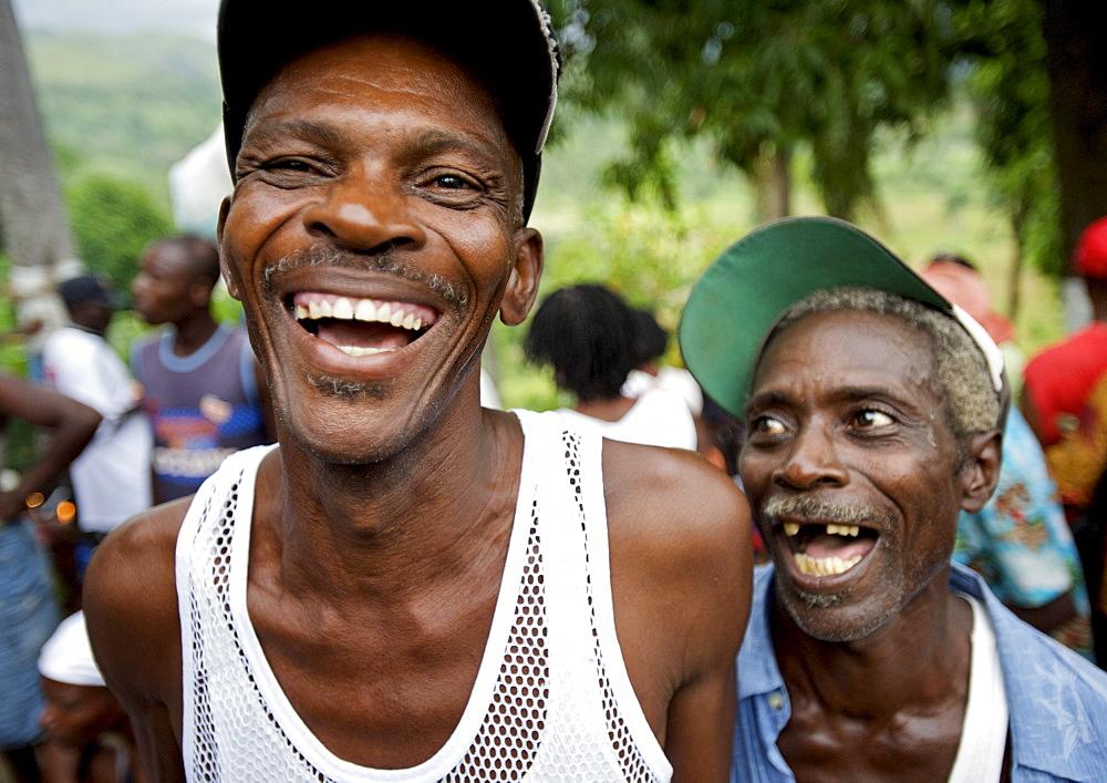 Two pilgrims laugh during the festivities surrounding the Saut D'eau voodoo pilgrimage in Haiti.