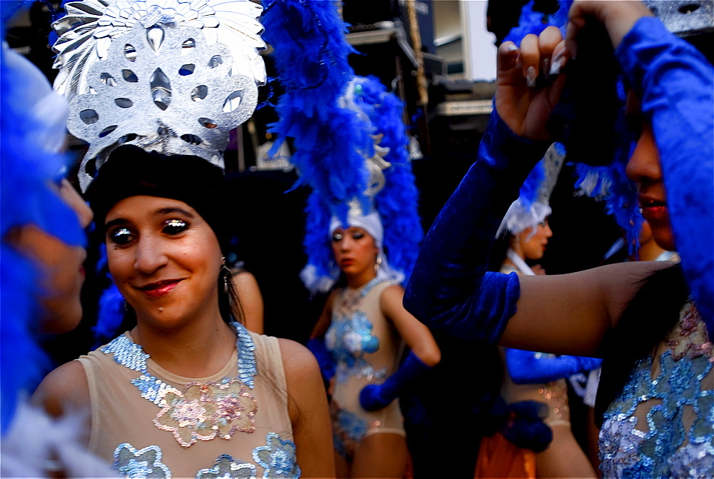 Costumed carnival dancers wait backstage in Merida, Venezuela.