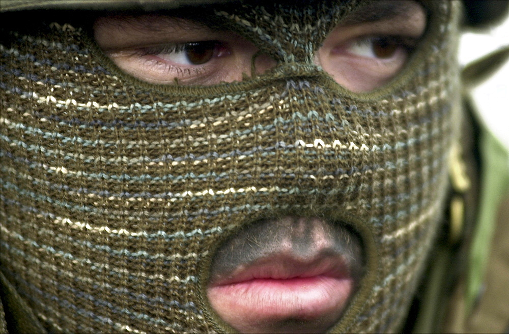 A US Navy man wears cold weather protection during an exercise in Northern California.