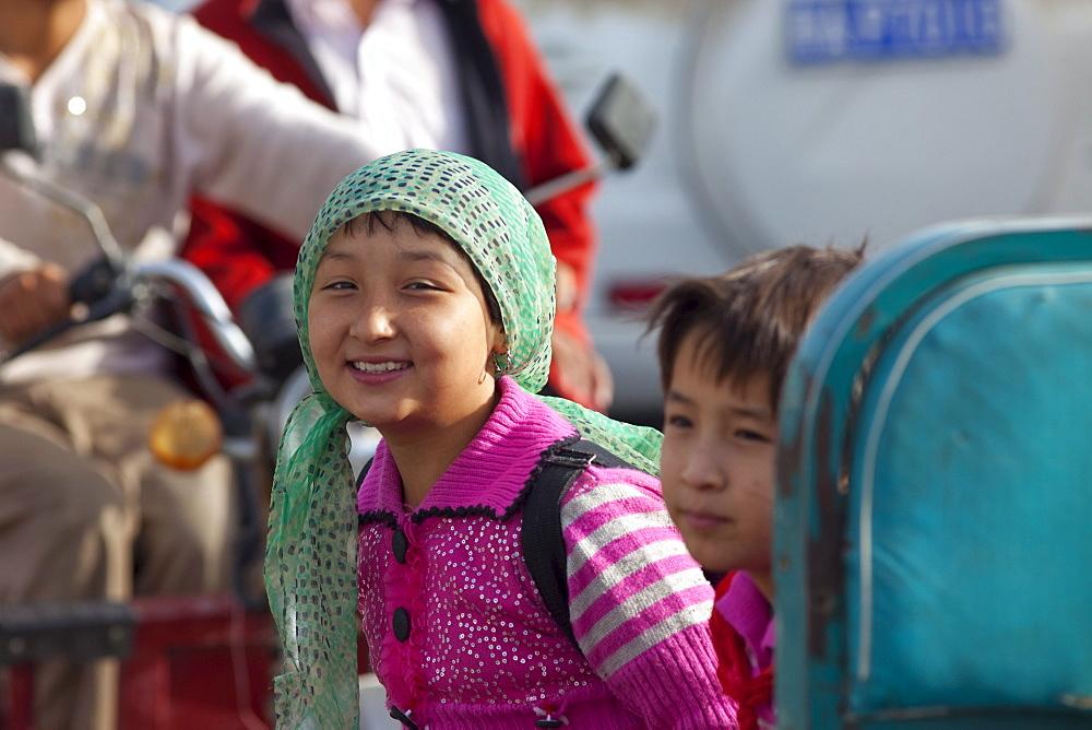 Young girls smiling in Hotan, Xinjiang, China.
