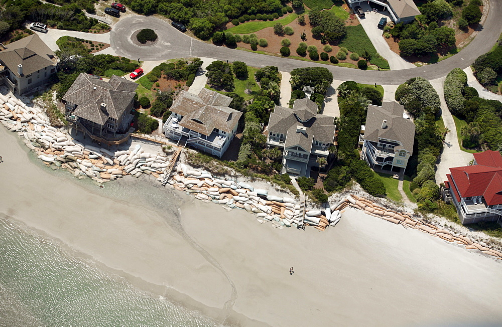 Aerial images of sadnbags on Figure Eight Island beach.