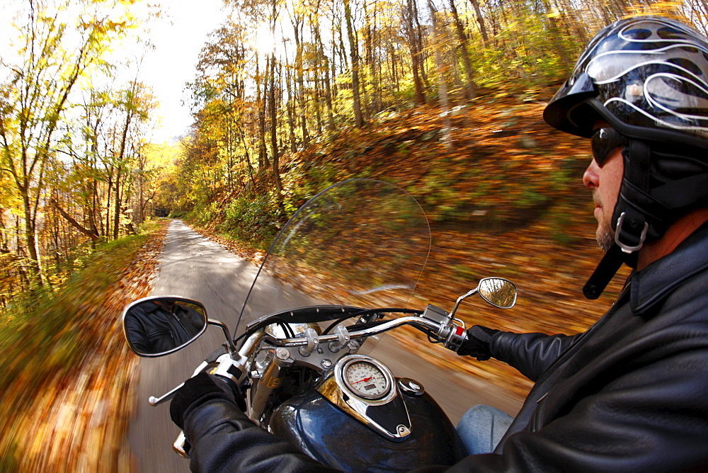 POV shot of motorcycle ride in autumn