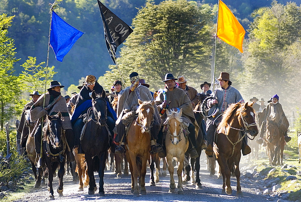 Chilean indigenous Mapuche communities cavalcade on horseback for their land and water resources in the Reigolil Valley of Chile.