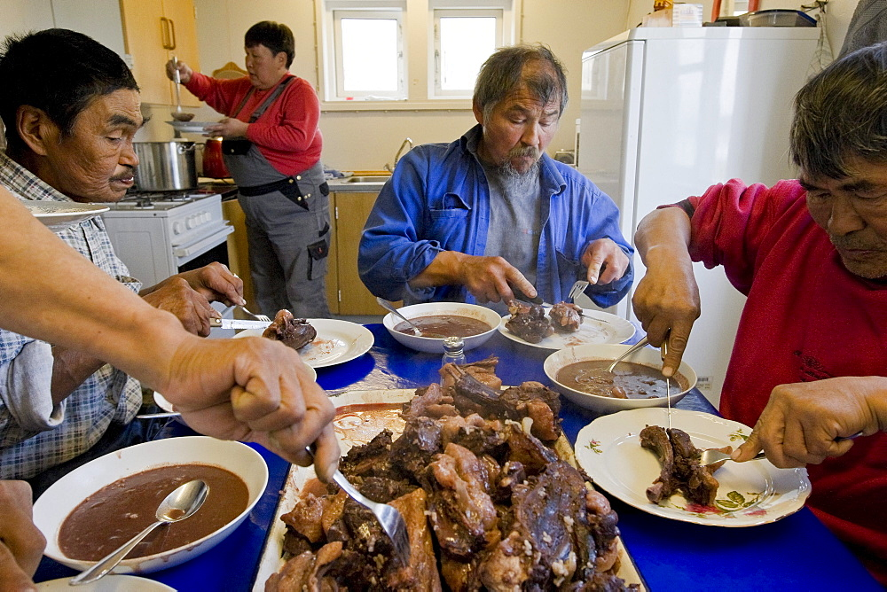 Workers Having Lunch in Eqaluit Ilua, Greenland.