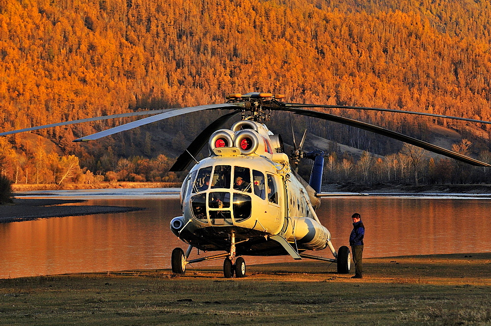 Helicopter delivers guests to fly fishing camp in Mongolia.