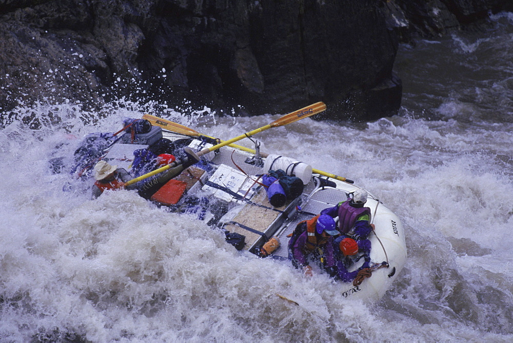 Rafts running the white water of Crystal Rapid, mile 98, Colorado River, Grand Canyon.