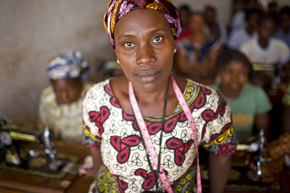 Sonie Zaima, 36 yrs old, teaches a course on  how to use a sewing machine in a local womans center in Voinjama, Liberia. After the long civil war employment opportunities remain few and capacity building a priority.