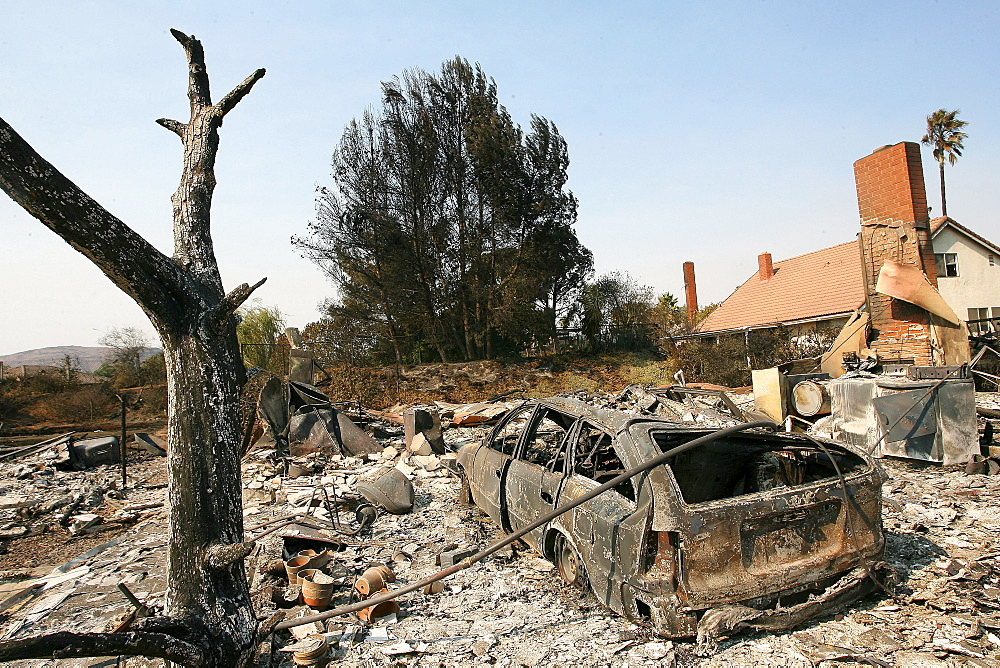 Charred remains of homes which were burned to the ground stand in a neighborhood of Rancho Bernardo in San Diego during the Southern California wildfires of 2007. More than a dozen homes were completely lost in the small neighborhood there.