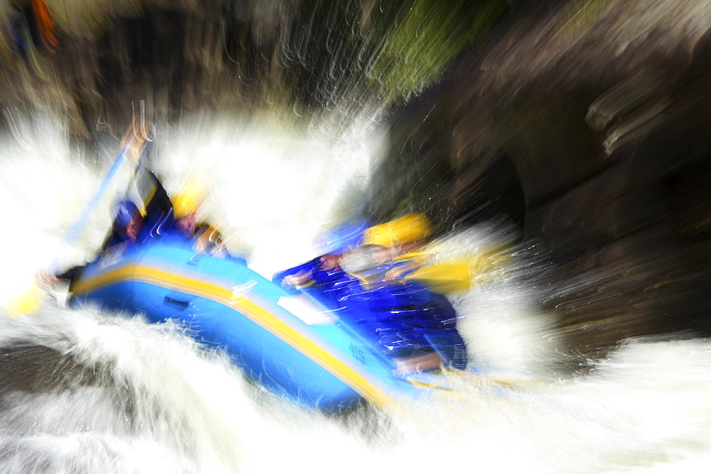 Motion-blur photo of unknown whitewater rafters crashing through Pillow Rock rapid on the Upper Gauley river near Fayetteville, WV