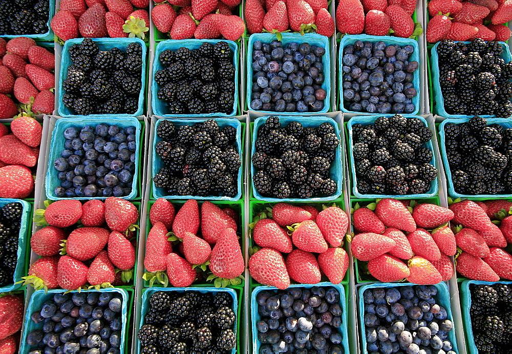 Blackberries, strawberries, blueberries at Farmer's market.