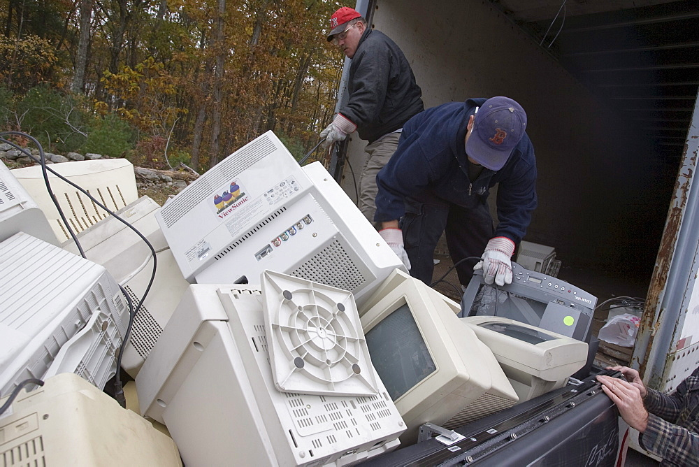 Workers load computers dropped off for recycling in Brockton, Massachusetts.