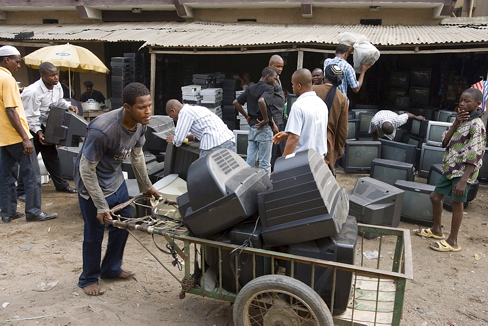 Alaba Market, Lagos Nigeria. Many of the computers here are second hand and shipped from Asia, the USA or Europe for reuse. The small shop dealers buy electronics from the containers and are very good at repairing the goods for sale. When material has no value is it sent to nearby dumps, and young men look for parts or wire that they recycle the metals. However, much toxic material ends up in these dumps in Nigeria.